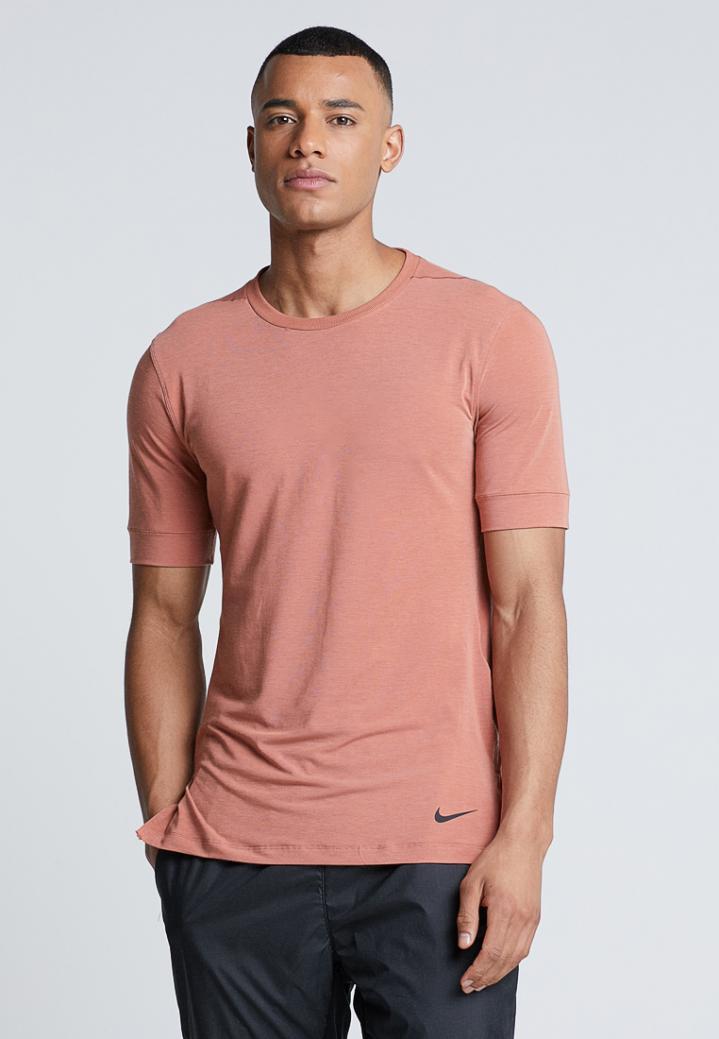 Tumor maligno Estúpido Brillante  Camisetas Nike Performance Hombre | DRY TOP SS TRANSCEND YOGA - Camiseta  básica dusty peach/bemis pitch - Education Lamp